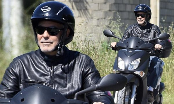 George Clooney enjoying a ride on a scooter